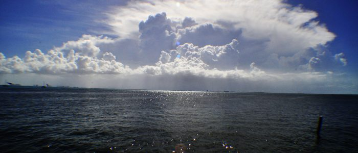 A view of clouds over water.